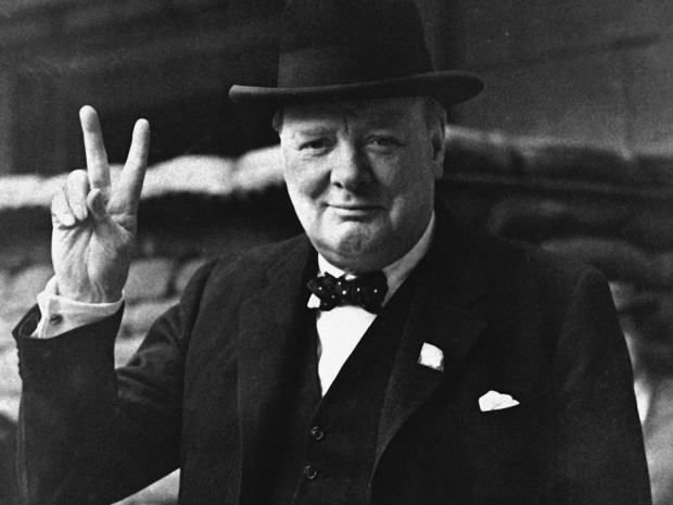 """FILE - This is a Aug. 27, 1941  file photo of British Prime Minister Winston Churchill as he gives his famous """" V for Victory Salute"""" . Churchill Britain's famous World War II prime minister died fifty years ago on January 24 1965. (AP Photo, File)"""